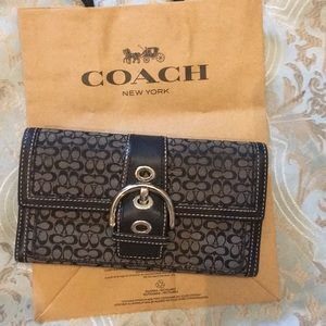 Coach tri fold wallet. Signature C with buckle